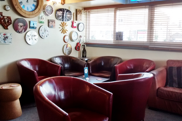 photo of the interior lounge area at the clockhouse bar